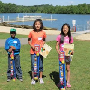 "The 2014 winners! From L to R: Darius McFarlane caught the smallest fish (2.5 inches); Yuriko Watanabe caught the most fish (10); and Shayla Nguyen caught the largest fish (6.5 inches). Winners received a fishing rod, tackle box and Montgomery Parks ""Complimentary Pass"" as prizes. Image Courtesy of Montgomery PArks"